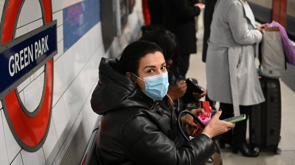A woman wears a mask on the Tube in central London