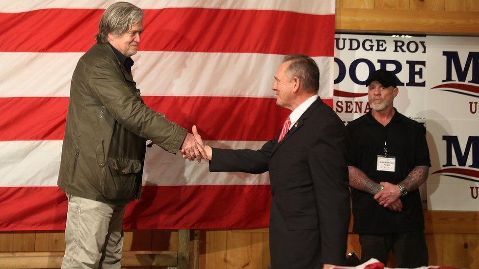 Republican Senatorial candidate Roy Moore is welcomed to the stage by Steve Bannon (L) as he introduces him during a campaign event at Oak Hollow Farm on December 5, 2017 in Fairhope, Alabama.