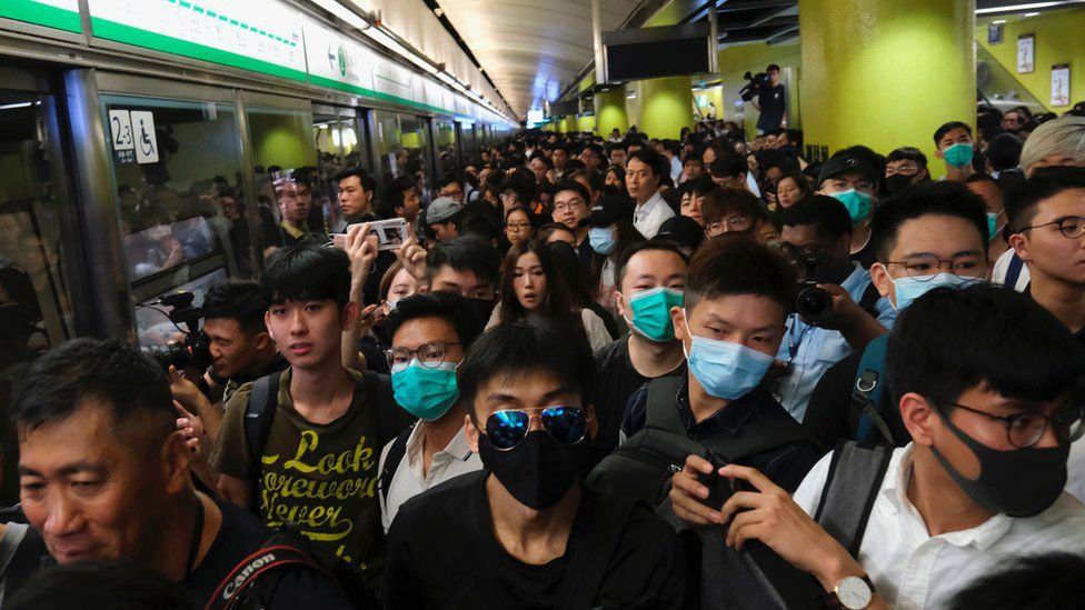 Train passengers queue as Anti-extradition bill protesters disrupt train services