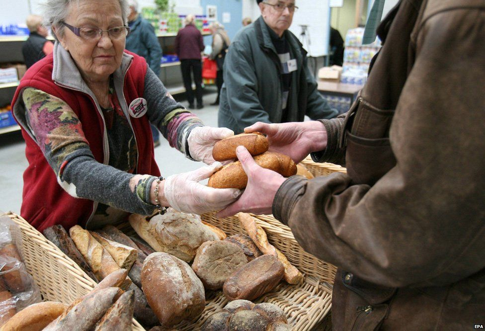 A volunteer delivers bread at the distribution centre of the Restos du Coeur