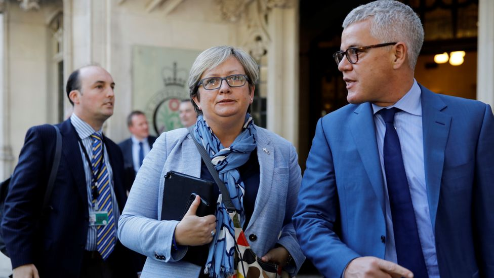 """Scottish National Party (SNP) MP Joanna Cherry (C) and Jolyon """"Jo"""" Maugham QC (R) leave the Supreme Court in central London, on the second day of the hearing into the decision by the government to prorogue parliament on September 18, 2019."""