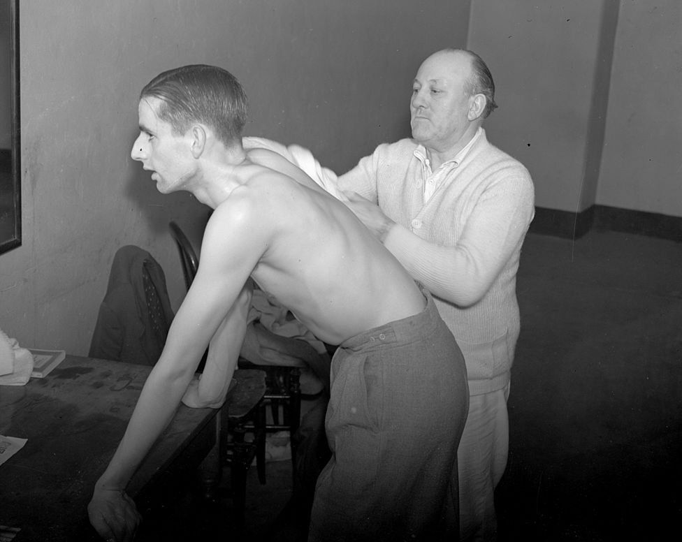 Table tennis player Eric Filby having a rub down after a playing an Irish contestant in a competition at the Royal Albert Hall, London. (Photo by London Express/Getty Images)