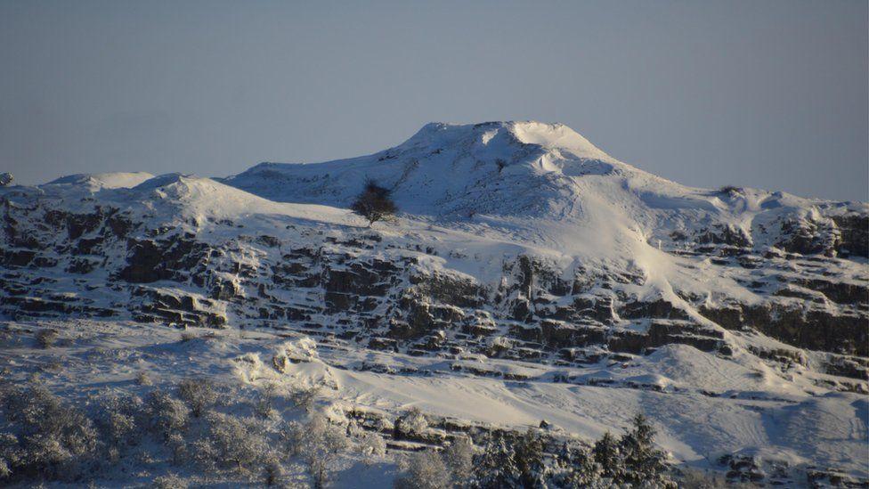 A snow-covered Morlais Castle in Merthyr Tydfil