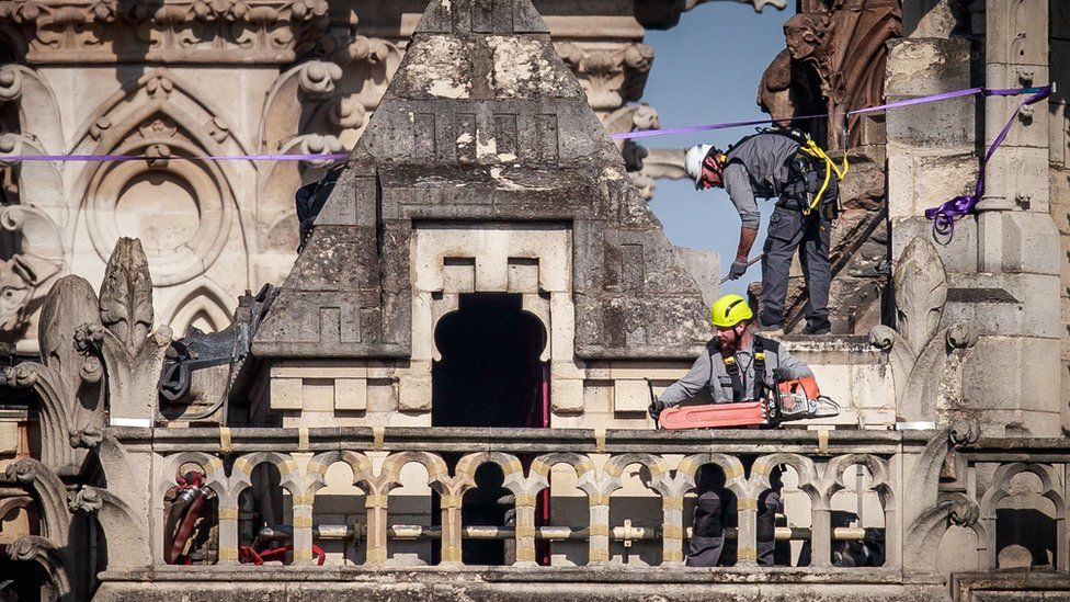 Workers consolidate the north face of Notre-Dame threatening to collapse in the aftermath of the fire