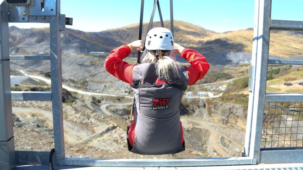Person in Zip World harness