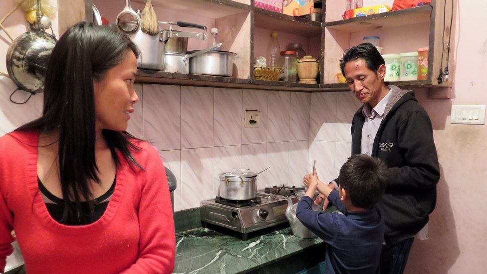 Wangda Dorje and Tshering Choden in the kitchen