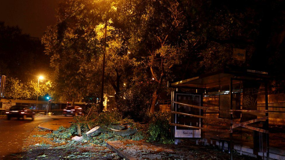 Branches of trees are seen on a street at Benfica neigborhood as hurricane Leslie goes past in Lisbon, Portugal October 14, 2018