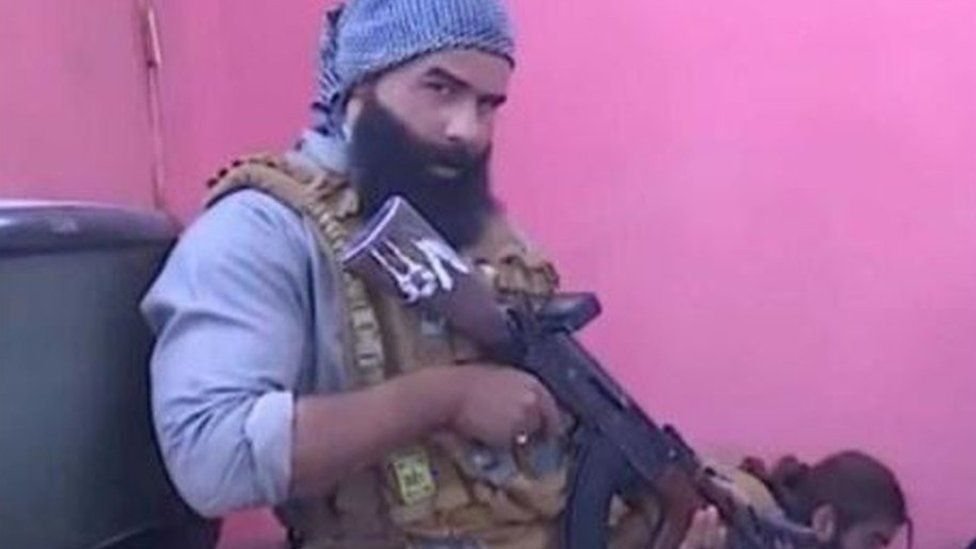 An actor holds a gun in the Iraqi prank show Raslan's Shooting