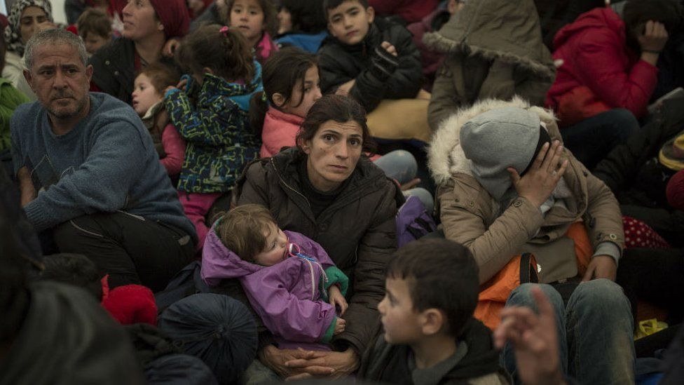 Refugee families queue to enter Macedonia at the Greek-Macedonia border in Idomeni. 3 March 2016
