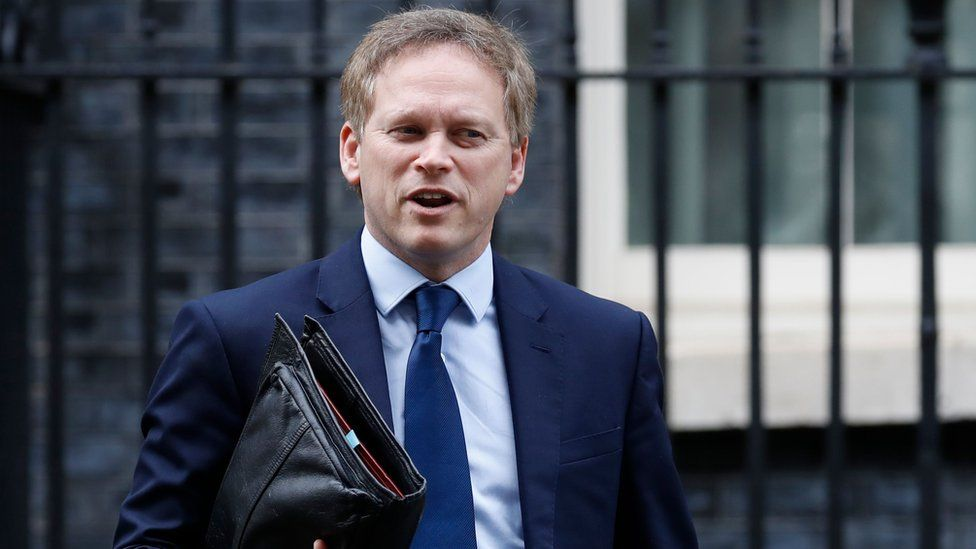 """Britain""""s Transport Secretary Grant Shapps leaves number 10, Downng Street in central London on March 17, 2020. - Britain stepped up its response to coronavirus, recommending household isolation, home-working and an end to mass gatherings to try to stem an accelerating outbreak."""