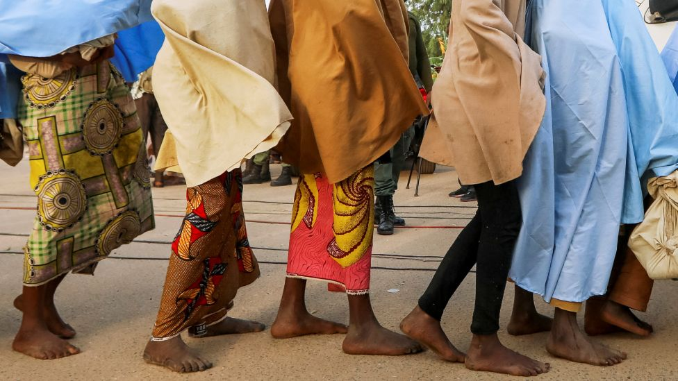 Girls who were kidnapped from a boarding school in the north-west Nigerian state of Zamfara walk in line after their release, in Zamfara, Nigeria -2 March 2021