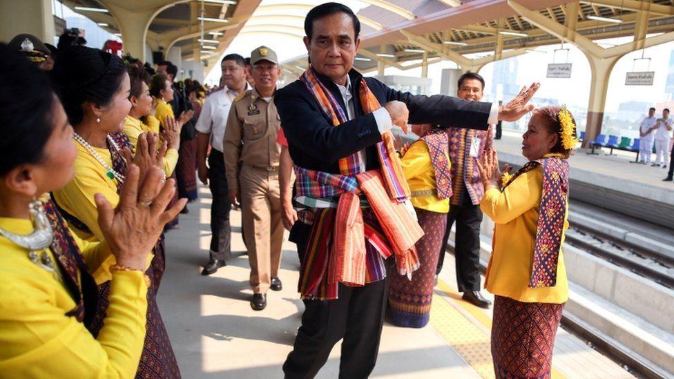 Thailand Prime Minister Prayuth Chan-ocha dances at a train station