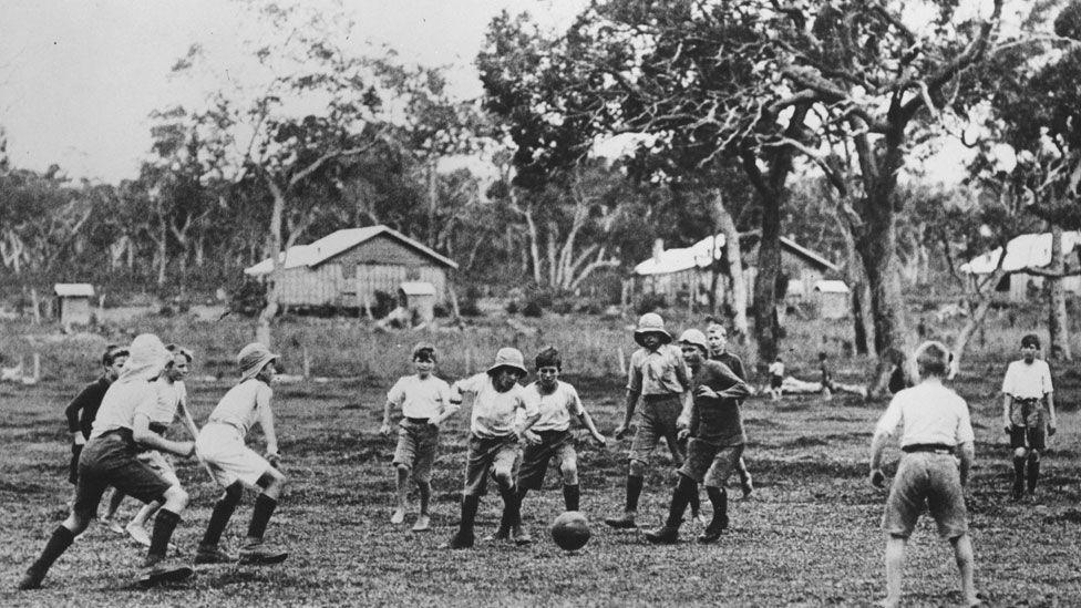 Boys play football at the Fairbridge school at Pinjarra
