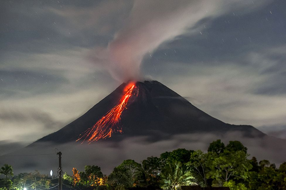 Lava flows down the side of Mount Merapi on 15 September 2021
