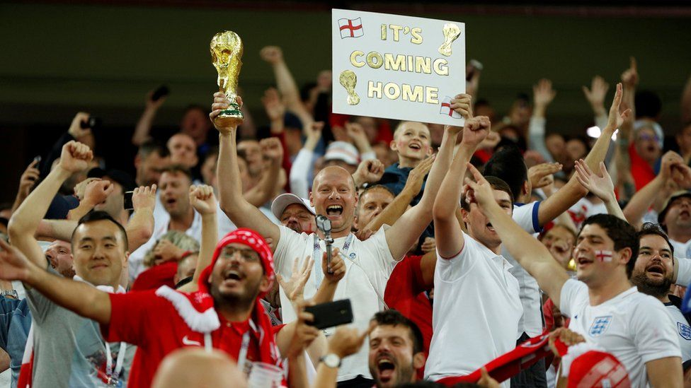 England fans celebrate after the game against Colombia