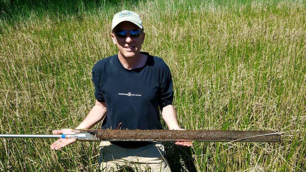 Scientist Patrick Mcgonigal working in a US coastal wetland (c) Genevieve Noyce/Smithsonian Environmental Research Center