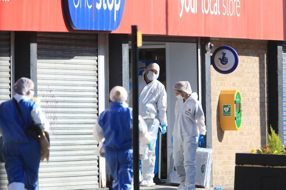 Forensics officers at the entrance to the One Stop Shop