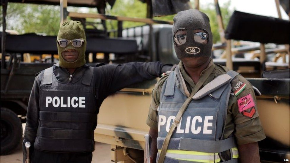 Nigerian police part of the joint forces in Borno state pose prior to a patrol in former Boko Haram headquarters in Maiduguri on June 5, 2013.