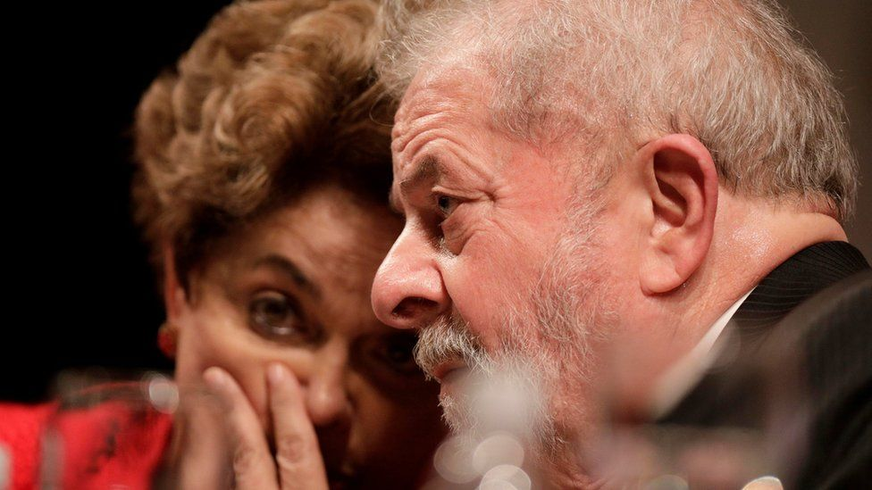"""Former Brazilian President Luiz Inacio Lula da Silva speaks with former Brazilian President Dilma Rousseff during the inauguration of the new National Directory of the Workers"""" Party, in Brasilia, Brazil July 5, 2017"""