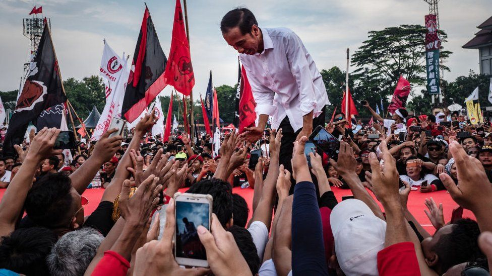 Indonesian incumbent Presidential candidate Joko Widodo, is greeted by his supporters at the Sriwedari stadium during election campaign rally on April 9, 2019 in Solo, Central Java, Indonesia.