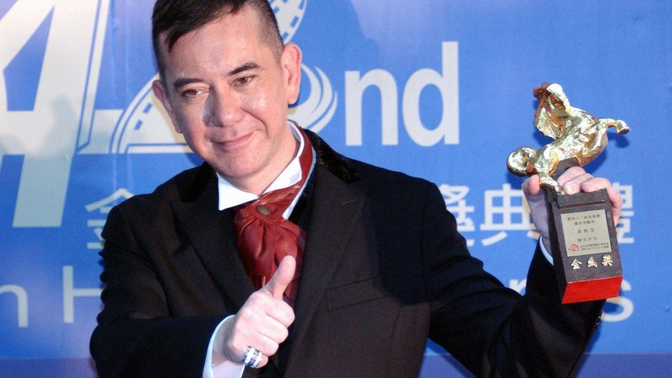 Hong Kong movie star Anthony Wong displays a trophy after winning the Best Supporting Actor at Keelung Culture Center 13 November 2005