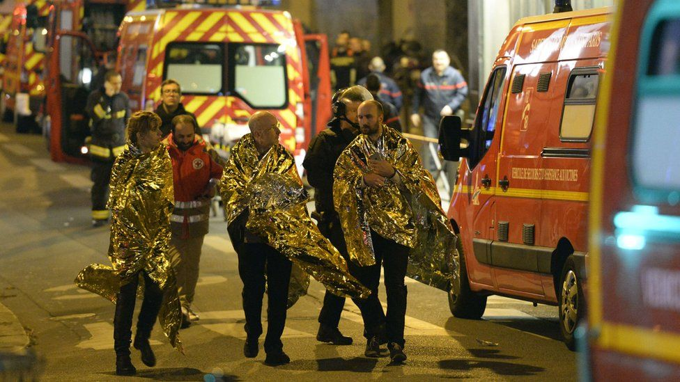 Survivors being led away on rue Oberkampf near the Bataclan concert hall in central Paris