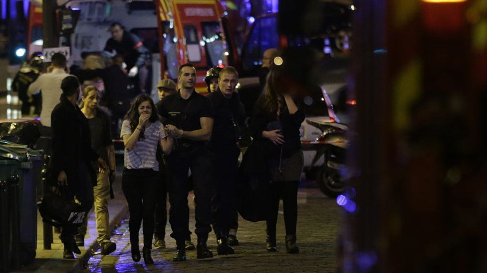 People are evacuated following an attack at the Bataclan concert venue in Paris, on November 13, 2015