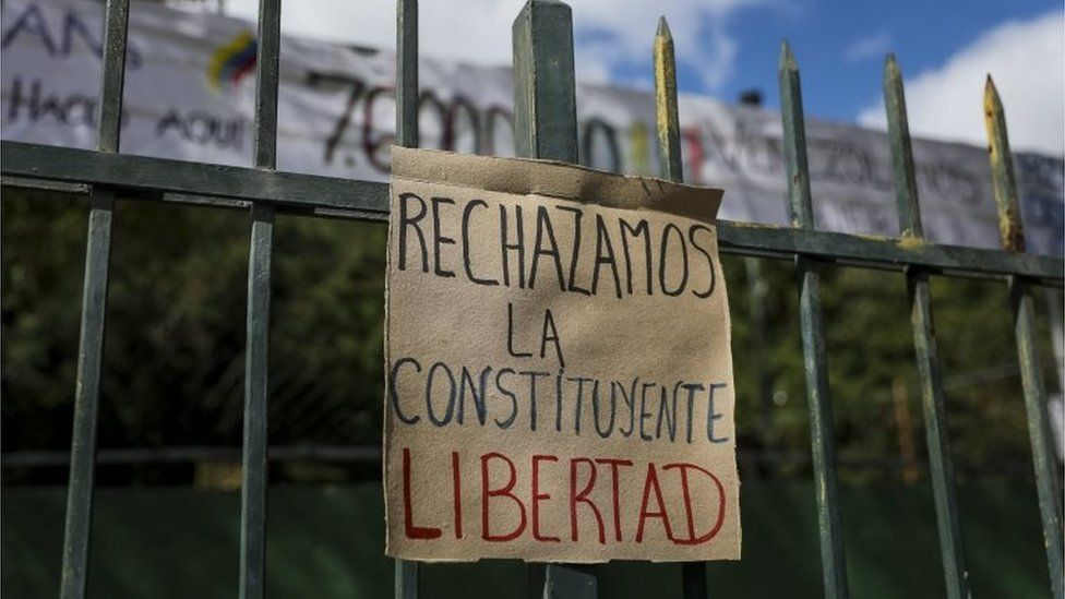 """A posted sign reads """"We reject the Constituent. Freedom"""" in front of a polling station in Caracas, Venezuela, 24 July 2017."""