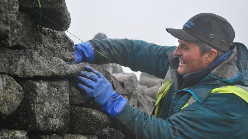 Norman McComb working on the Mourne Wall