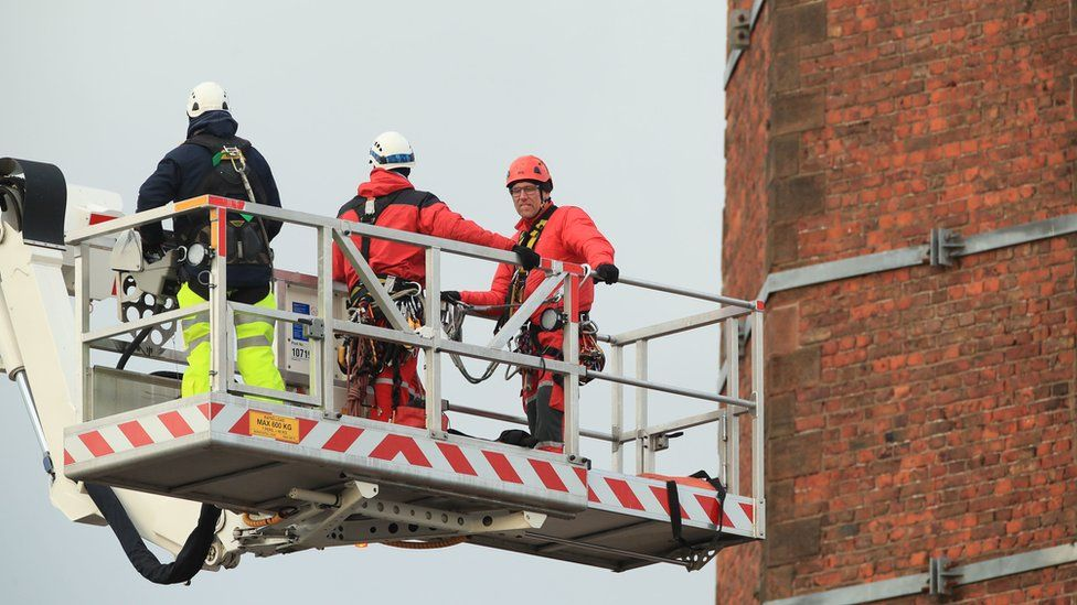 Search and Rescue team members from Lancashire Fire and Rescue Service use a hydraulic platform