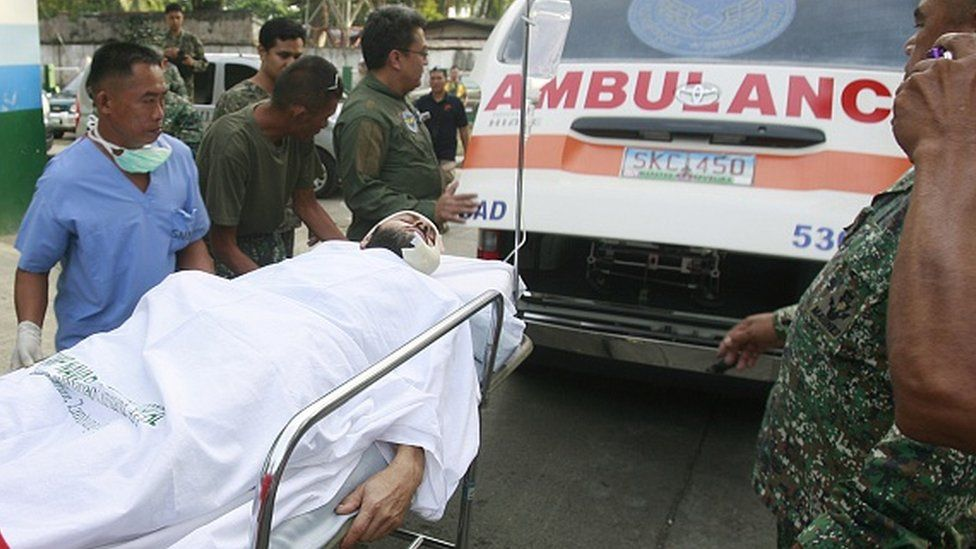 Lorenzo Vinciguerra on a stretcher in the Philippines