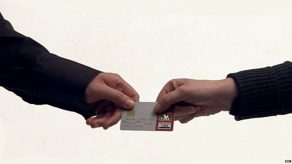 Couple handing over credit card