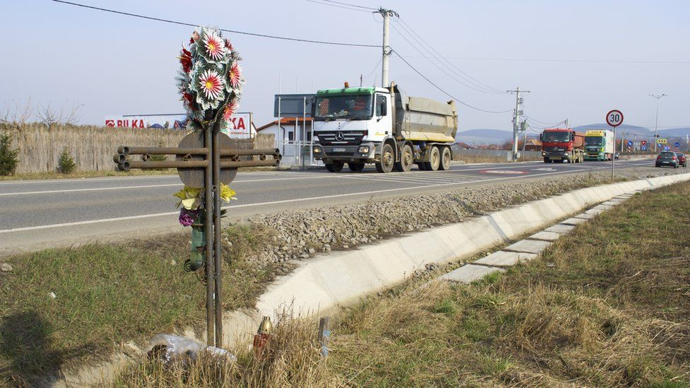 A cross marks a fatal accident on a road in Mures County in Romania