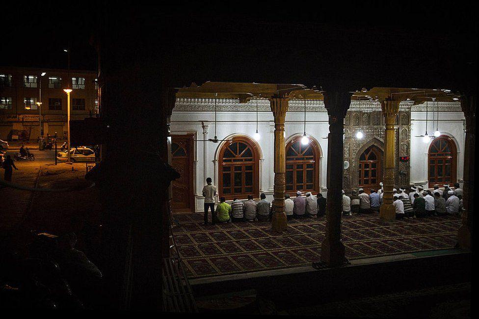 Uyghur men pray at an open air mosque on July 31, 2014 in old Kashgar, Xinjiang Uyghur Autonomous Region, China.