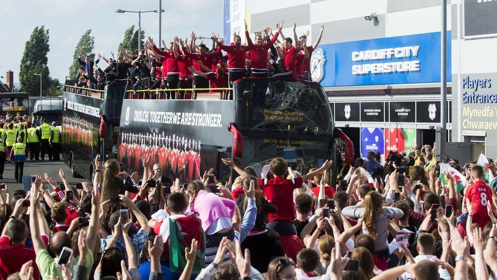 Fans greet Wales team