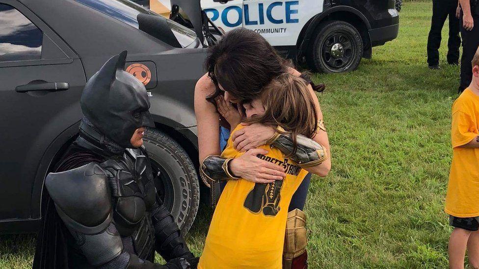 Batman, Wonder Woman and Garrett's sister at the Celebration of Life