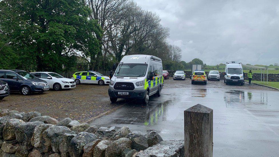 Police cars in a car park