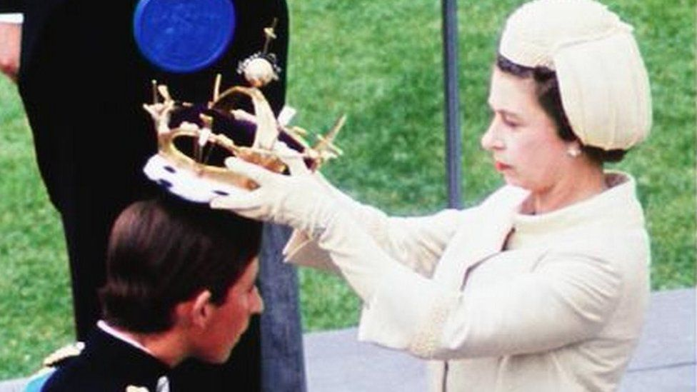 The Queen places a crown on Prince Charles' head at his investiture in 1969