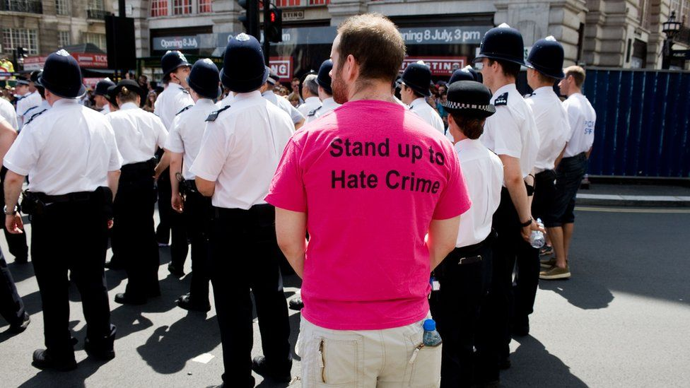 Man protesting against hate crime
