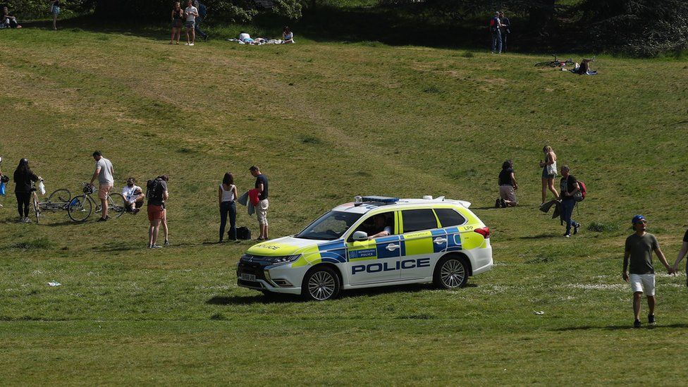 Police officers patrol Greenwich Park, London