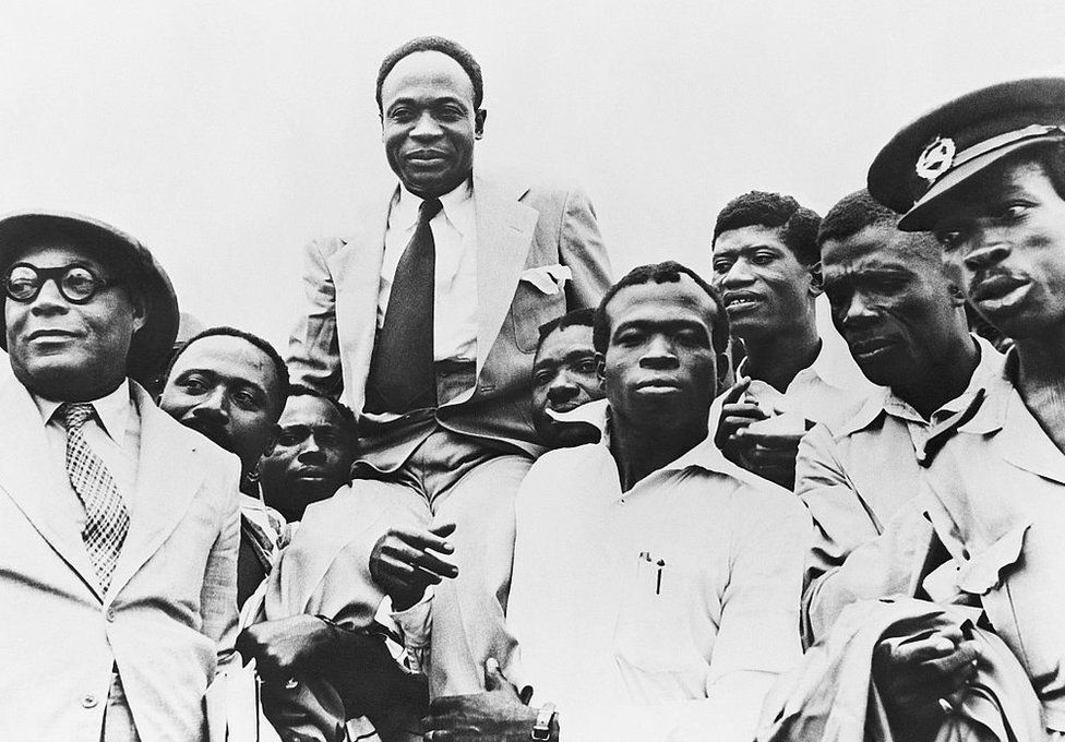 Government officials carry Prime Minister and President Kwame Nkrumah on their shoulders after Ghana obtains its independence from Great Britain.