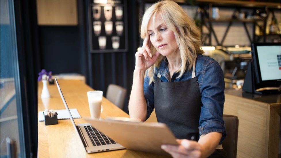 A woman looking anxious at work