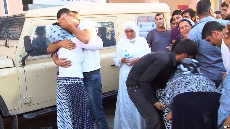 Mourners outside a hospital in Cizre