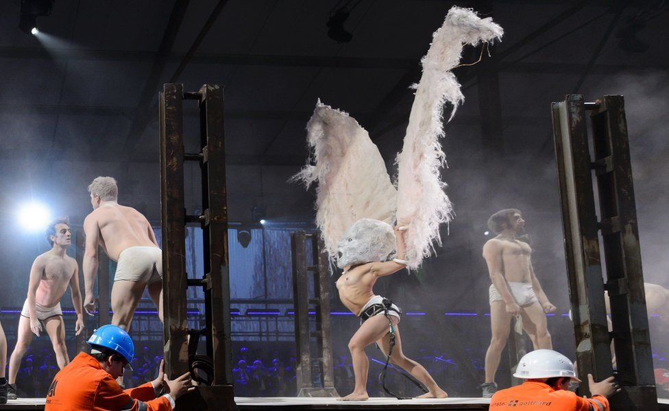 Artists perform during a show on the opening day of the Gotthard rail tunnel