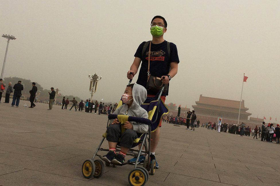 People visit Tiananmen Square as a dust storm hits Beijing, China 4 May 2017.