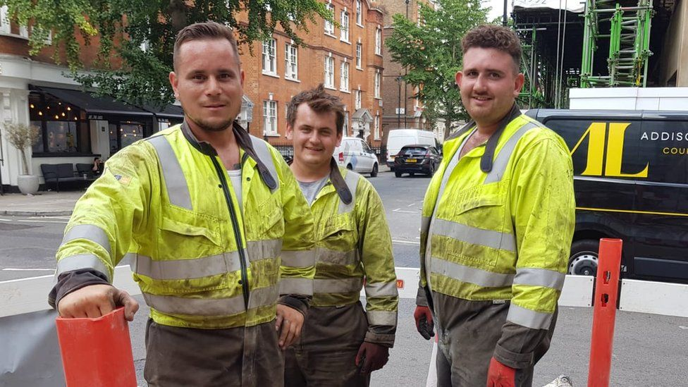 Labourers Peter Wackett, Jake Phillips and Luke Cahalane said they sweat lots in their overalls when it is hot