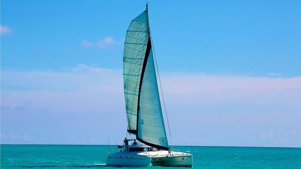 A picture of catamaran Destiny II at sea