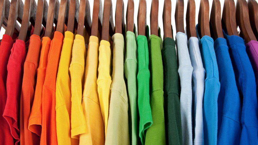racks of coloured t-shirts