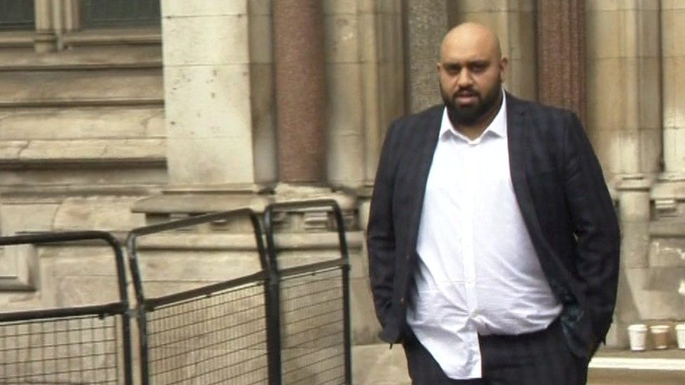 Atwal leaving the Royal Courts of Justice