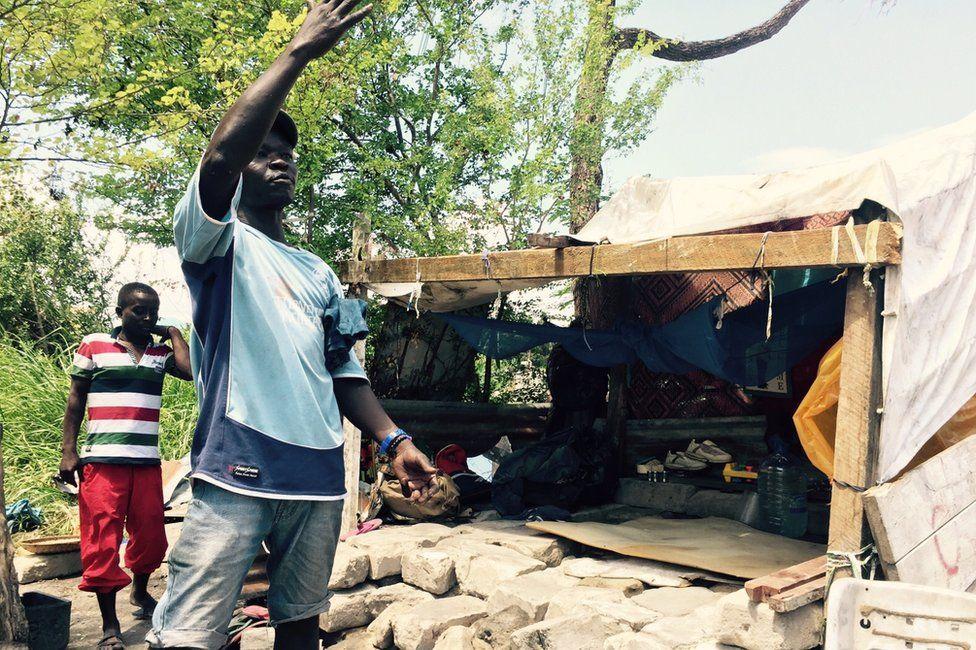 Mohamoud Shabiki, whose house has been demolished in Dar es Salaam, Tanzania, gestures